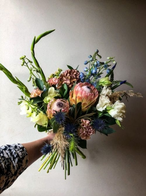beautiful bunch of flowers including a protea