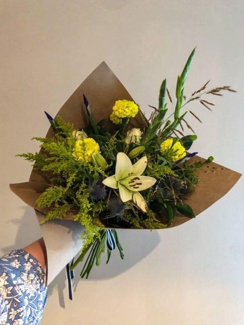 yellow white and green flower buncg